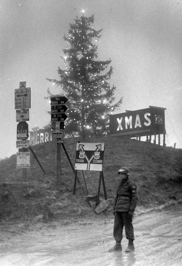 Photo 9a - The 169th ECB road signs and Merry Christmas on Highway 65 - Winter 1944